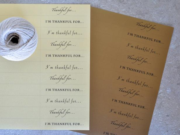 "Create a few templates with the words ""I'm thankful for..."" in different fonts. Print them out on four sheets of card stock."