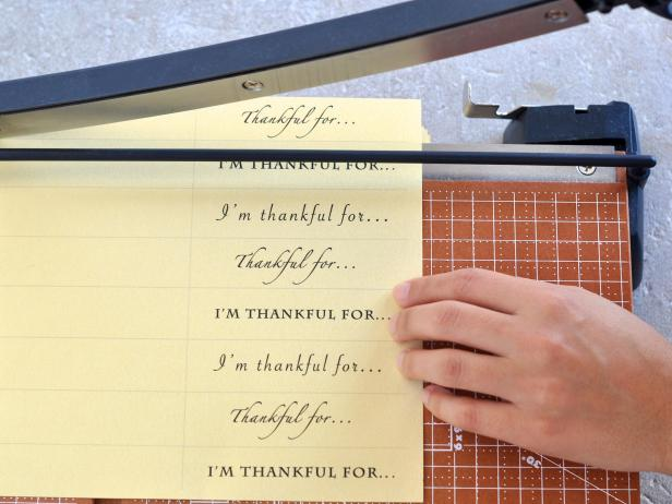 Use paper cutter or scissors to cut strips along template guidelines.