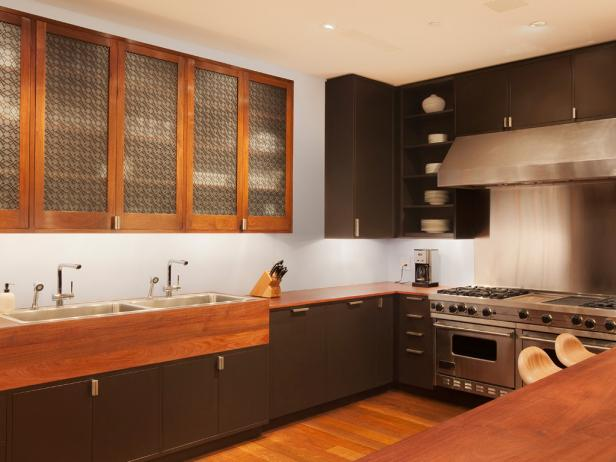 Sleek Contemporary Kitchen With Warm Wood Tones and Custom Cabinetry