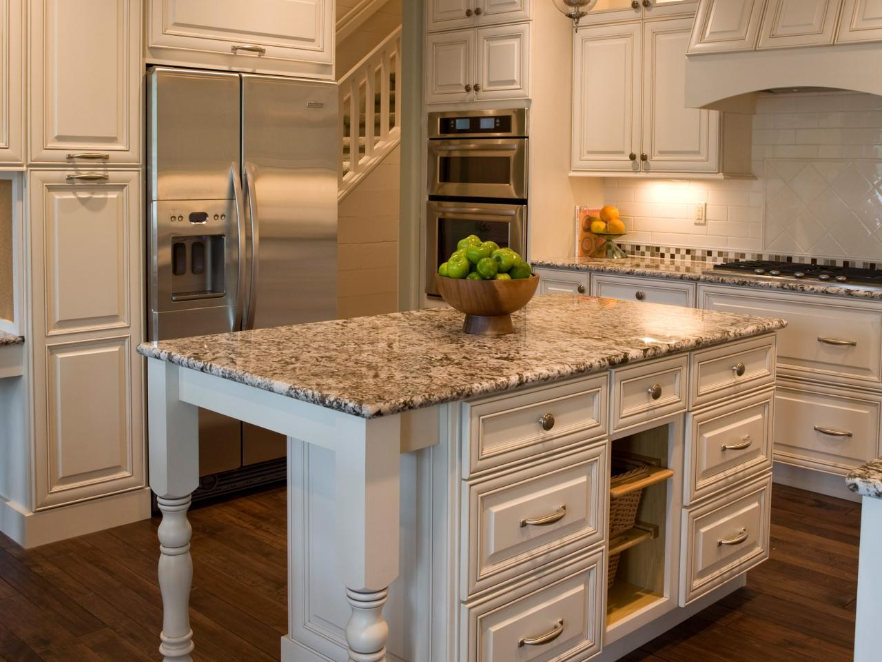 Granite countertop prices pictures ideas from hgtv hgtv White kitchen cabinets with granite countertops photos