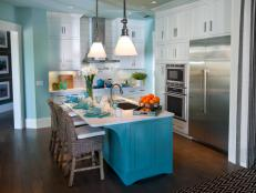 Blue Coastal Kitchen With Large Island and White Cabinetry