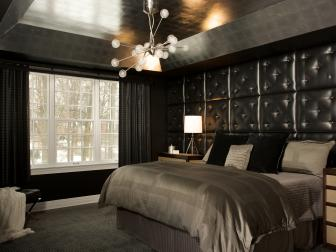 Striking Black Bedroom With Tufted Leather Headboard