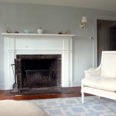 White Fireplace and Armchair