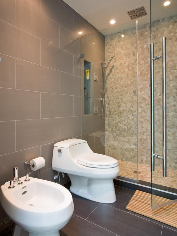 Gray Bathroom With River Rock Shower and Bidet
