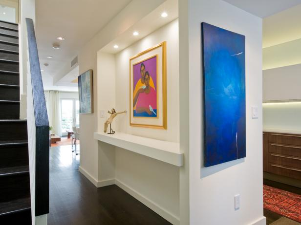 Modern White Hallway With Colorful Artwork