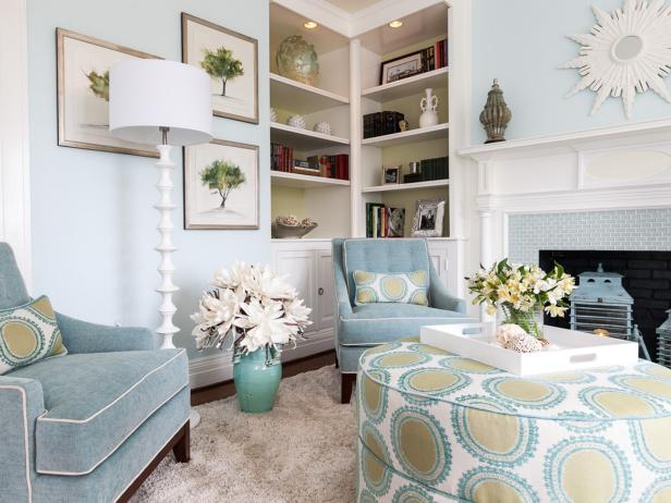 Blue Chairs with White Floor Lamp, Built-In Bookshelves and White Fireplace Mantel