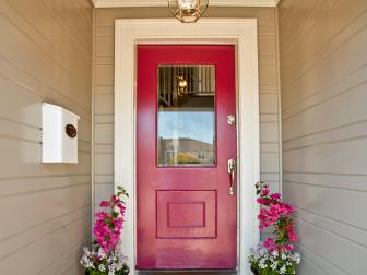 Townhouse Entryway With Red Front Door and White Molding
