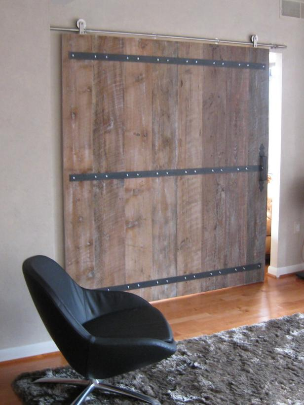Sliding Barn Door and Black Leather Chair with Shaggy Rug
