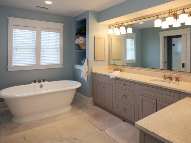 Double Vanity Bathroom With Freestanding Tub and Built-In Shelving