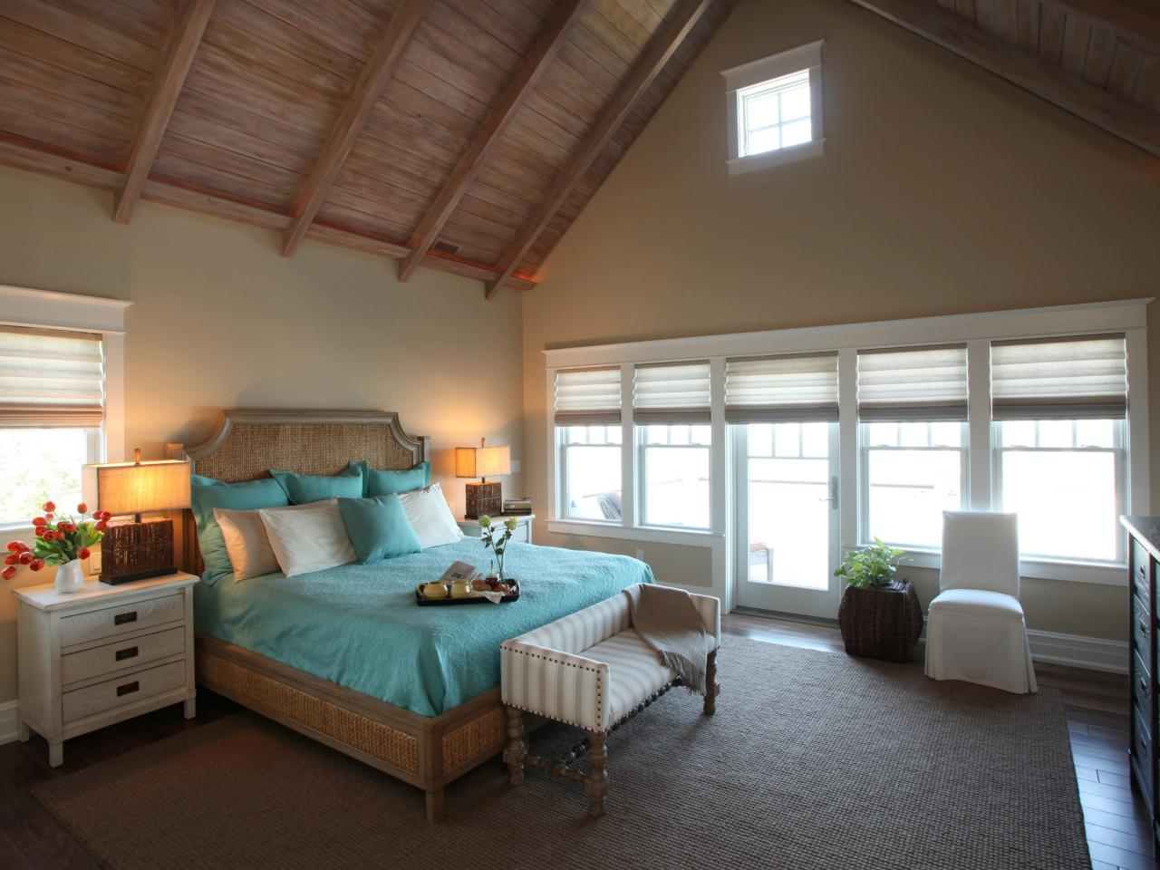 vaulted ceiling expands neutral cottage bedroom with the exception of