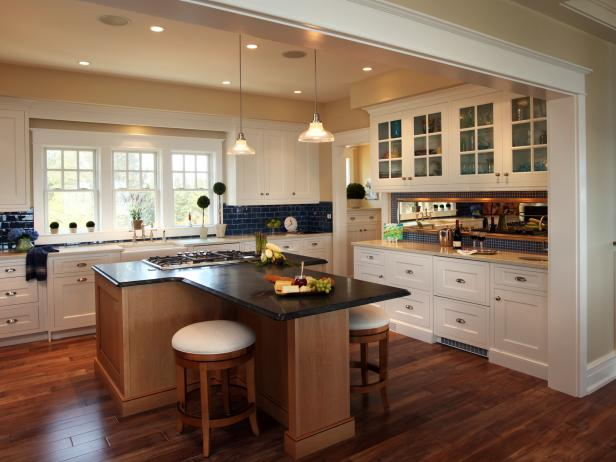 Kitchen With White Cabinets, Blue Tile Backsplash and Large Island