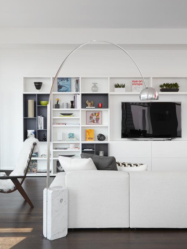 Sleek Living Room With Wall Storage and Metallic Floor Lamp