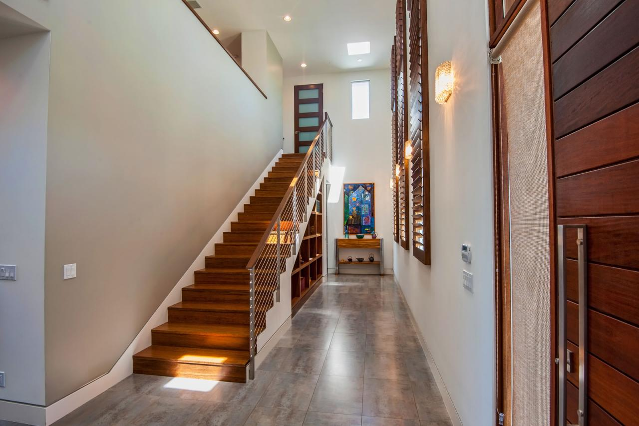 Modern neutral hallway with warm wood stairs this Design ideas for hallways and stairs