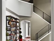 Dramatic Entryway With Industrial-Rustic Bookcases