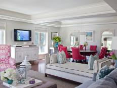 White Living and Dining Area With Raspberry Accents