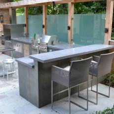 Backyard Sanctuary With Bar Area With Concrete Countertops