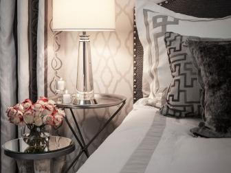 Master Bedroom with Graphic Patterns and Modern Lamp