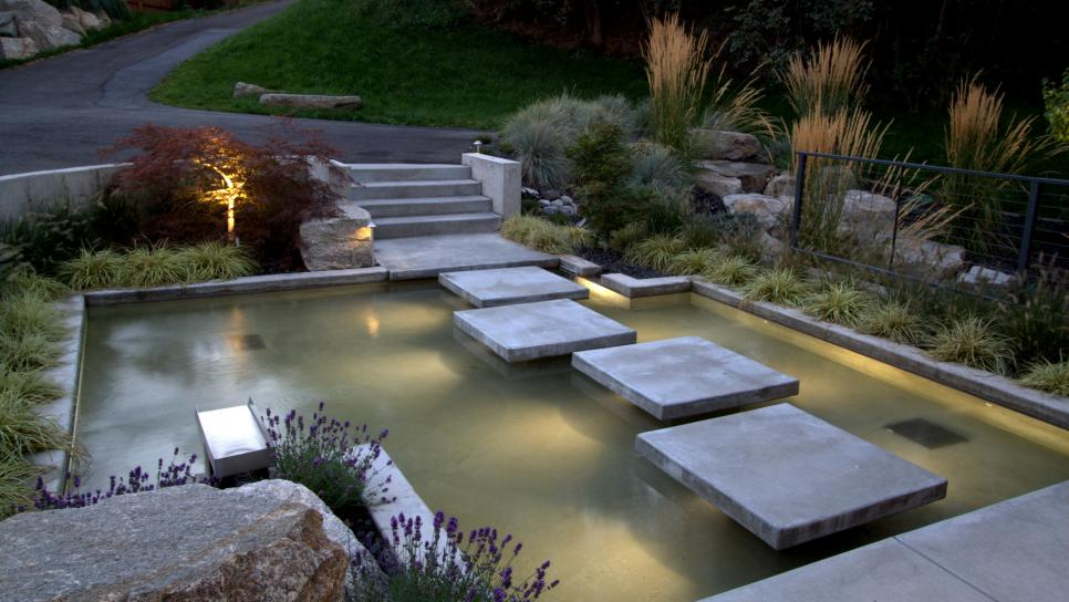 Shimmering Garden Pond With Stepping Stones Alderwood