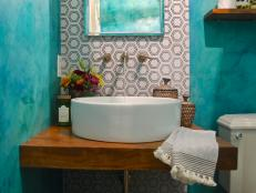 Teal Powder Room With Round Basin Sink and Wood Countertop