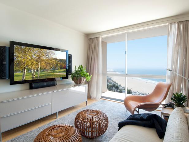 Modern Oceanfront Living Room With Rattan Ottomans
