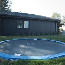 Modern Home and Backyard With In-Ground Trampoline