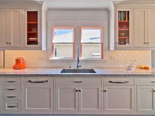 Timeless White Family Kitchen With Pop of Orange