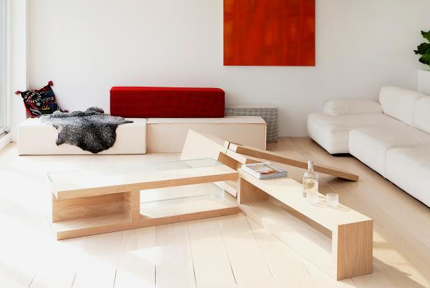 Modern Living Room with Wood Plank Table and Bold Red Art