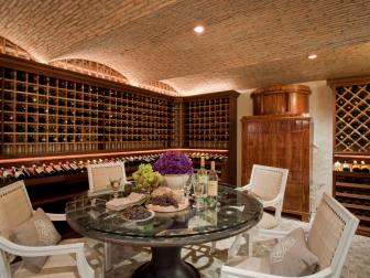 Neutral Mediterranean Wine Cellar Boasts Dining Area