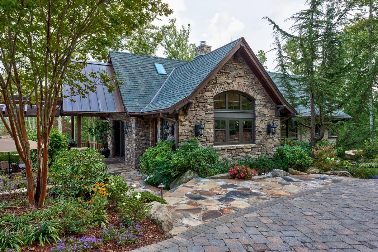 Rustic guest house stone exterior and walkway nestled next for Stone house floor plans