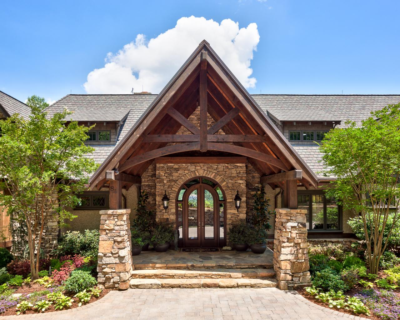 Rustic Mountain Retreat With Stone Exterior And Grand Entryway A New Entry For This Renovated Home Exteriors
