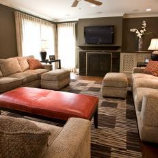 burnt orange accents pop in brown living room - Burnt Orange And Brown Living Room