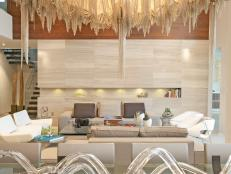 Formal Living Area Boasts Impressive Gold Chandelier