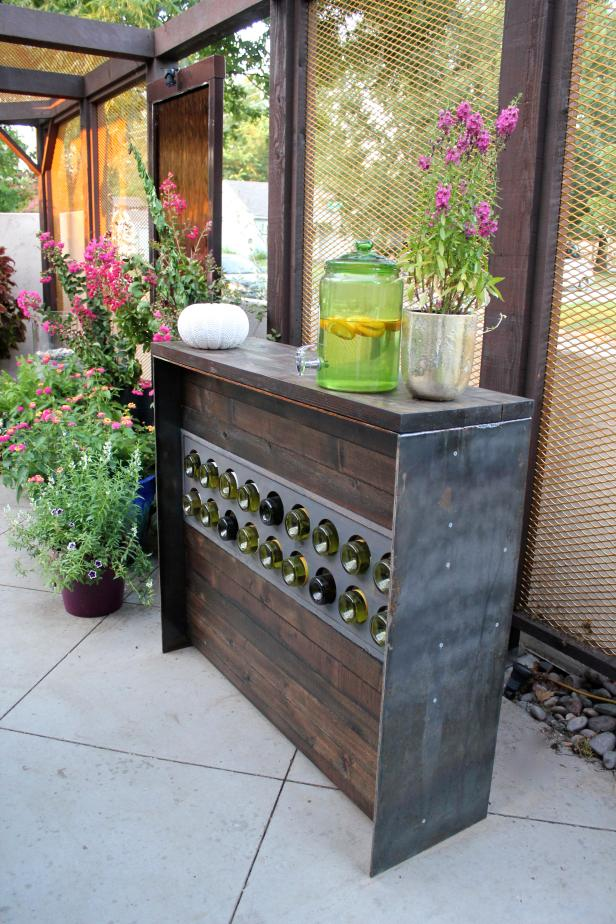 Flowering Plants Grace a Rustic Outdoor Sideboard Wine Rack