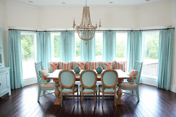Coastal Dining Room With Aqua Decor and Ornate Chandelier