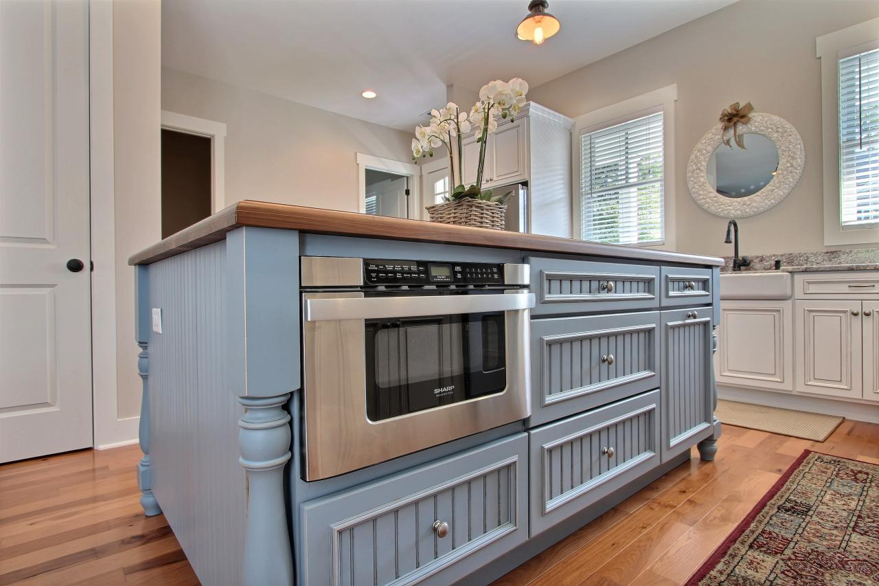 blue country kitchen island with built in microwave this