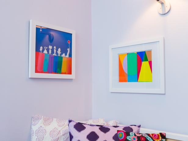 Colorful Artwork and Patterned Pillows in Girl's Bedroom