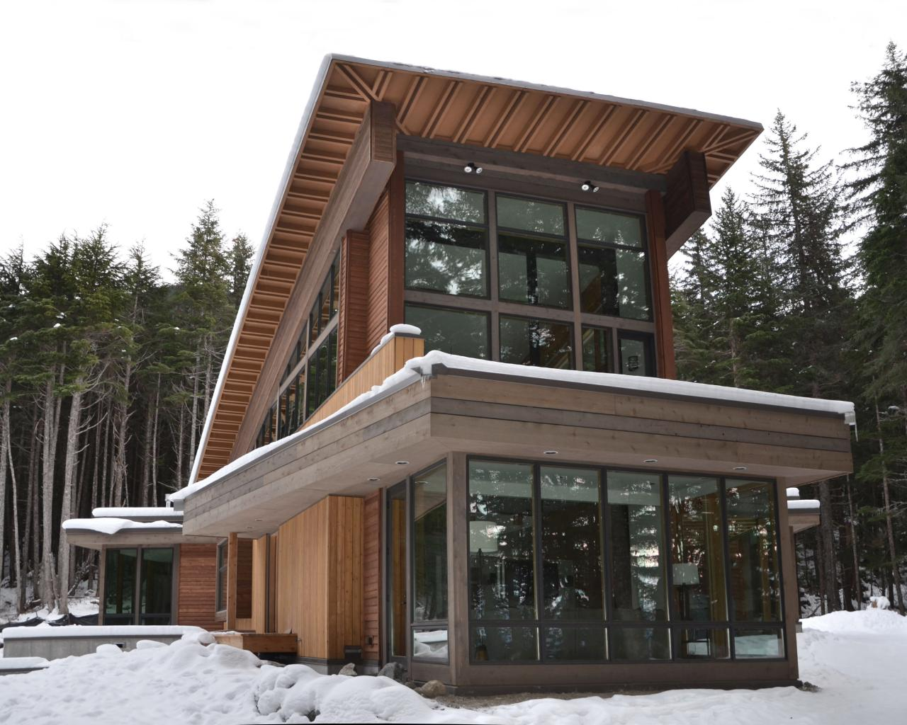Modern alaskan cabin boasts soaring windows with sharp for Home builders alaska