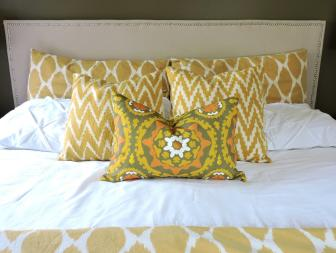 Stylish Yellow Patterned Pillows Energize Bedroom
