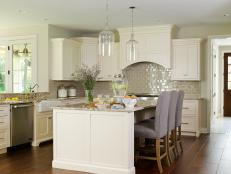 Transitional Kitchen With Eat-In Island and White Cabinets