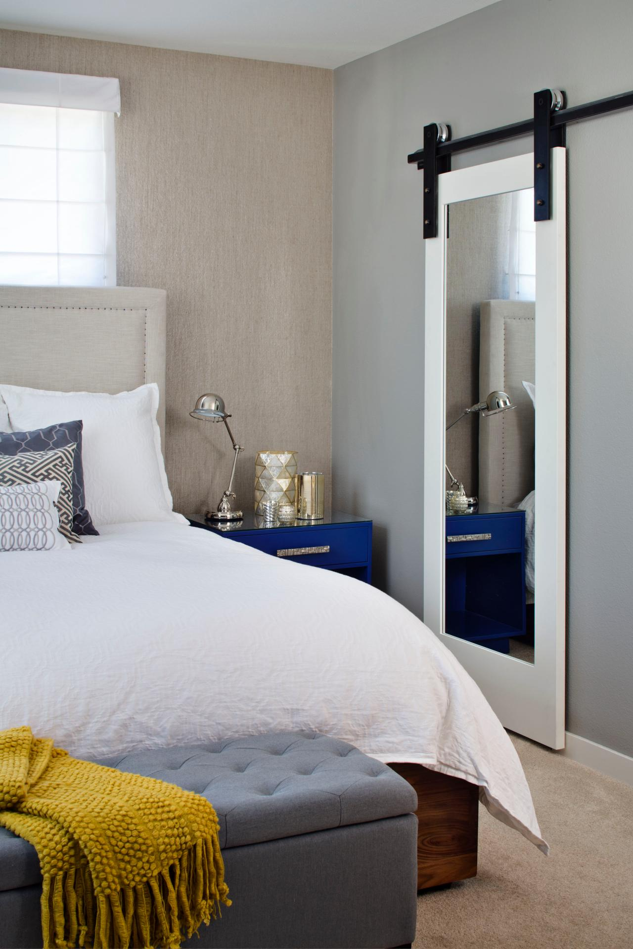 Barn-Door Mirror In Neutral Transitional Bedroom