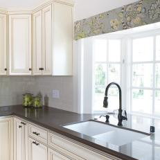 Cottage Kitchen With Bay Windows And Custom Glazed Cabinets