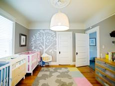Modern Twin Nursery With Charming Wall Art