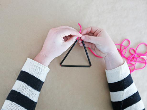 Step 4: Form straws into a triangle, then loop the string around in a loose knot.