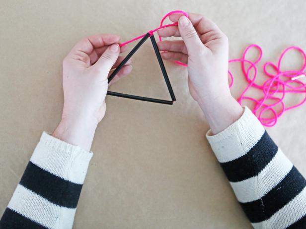 Step 4: Form straws into a triangle, then loop the string around in a loose knot. You want to leave just a little give to allow the ornament to take shape.