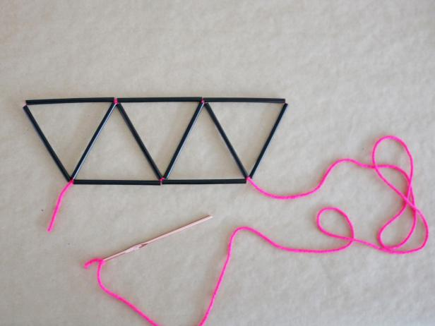 Step 5: Add more straw pieces until you have five triangles total.
