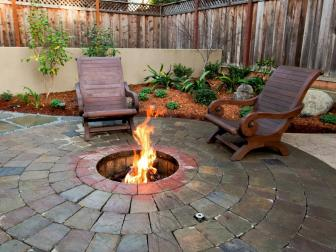 Backyard Fire Pit With Wooden Armchairs