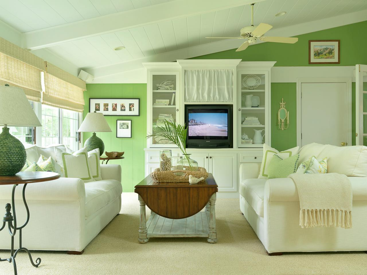 Green cottage living room with plush white sofas light Living room ideas with light green walls