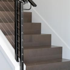 Sleek Modern Staircase With Steel Cable Railing And Black Handrails