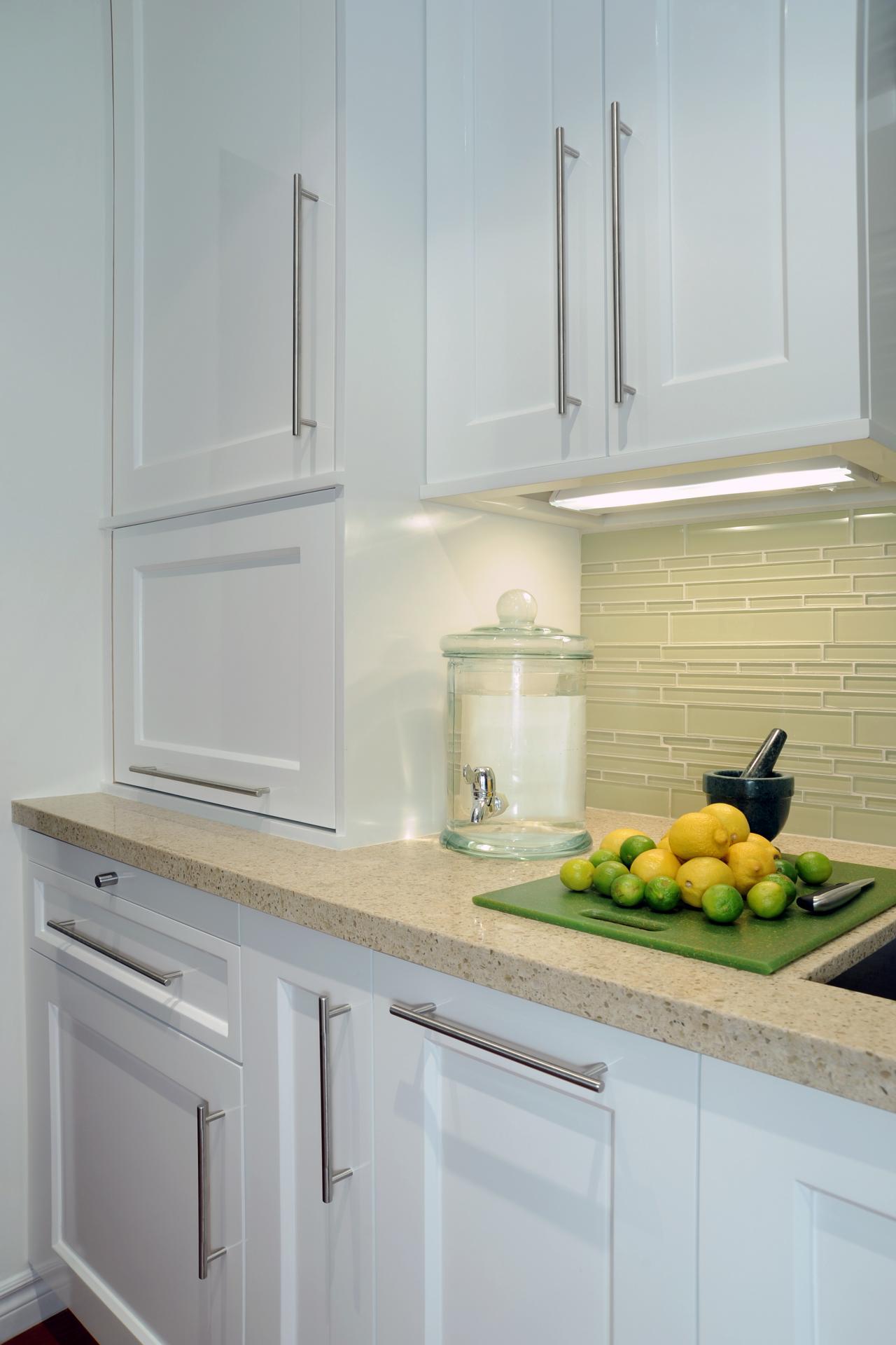 white kitchen cabinets and green glass tile backsplash this kitchen s