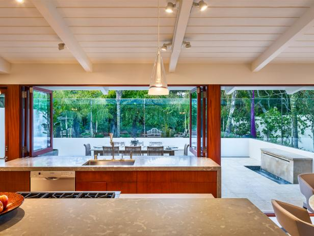 Modern Kitchen With Limestone Countertops and Mahogany Cabinetry